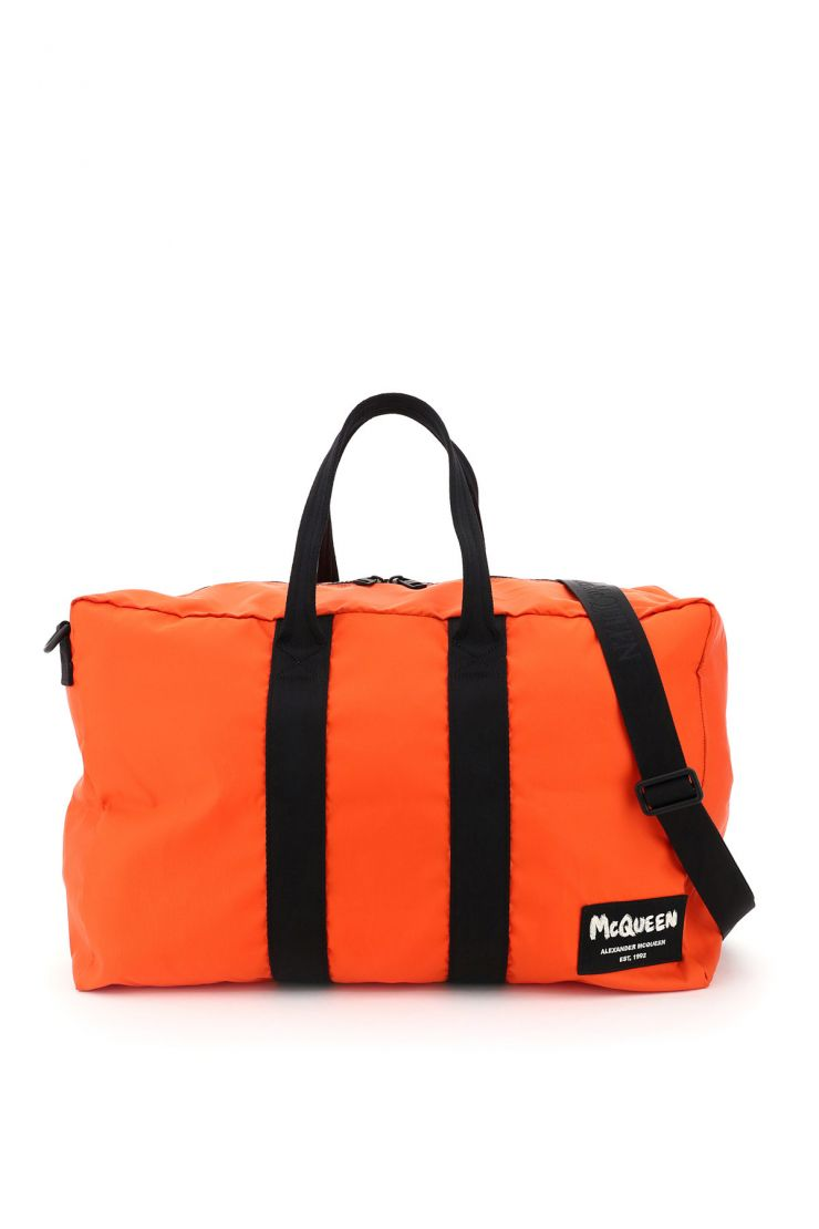 alexander mcqueen business and travel bags nylon duffle bag with graffiti logo patch